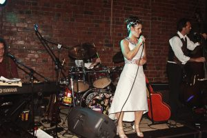 bride_singing_song_with_band